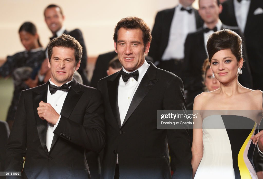 Director <a gi-track='captionPersonalityLinkClicked' href=/galleries/search?phrase=Guillaume+Canet&family=editorial&specificpeople=240267 ng-click='$event.stopPropagation()'>Guillaume Canet</a>, actor <a gi-track='captionPersonalityLinkClicked' href=/galleries/search?phrase=Clive+Owen&family=editorial&specificpeople=201515 ng-click='$event.stopPropagation()'>Clive Owen</a> and actress <a gi-track='captionPersonalityLinkClicked' href=/galleries/search?phrase=Marion+Cotillard&family=editorial&specificpeople=215303 ng-click='$event.stopPropagation()'>Marion Cotillard</a> leave the Premiere of 'Blood Ties' during the 66th Annual Cannes Film Festival at the Palais des Festivals on May 20, 2013 in Cannes, France.