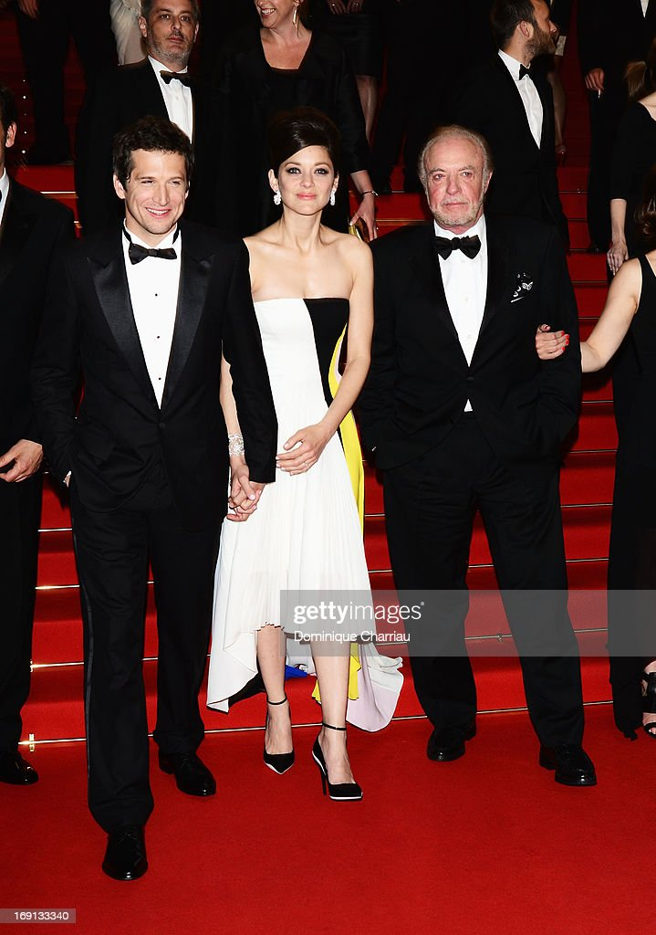 Director Guillaume Canet, actress Marion Cotillard and James Caan leave the Premiere of 'Blood Ties' during the 66th Annual Cannes Film Festival at the Palais des Festivals on May 20, 2013 in Cannes, France.