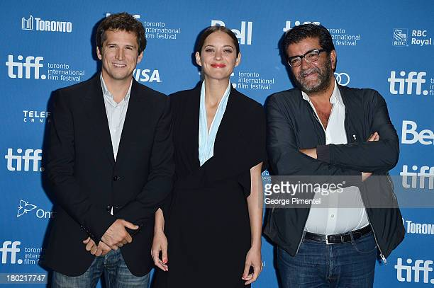 Director Guillaume Canet Actress Marion Cotillard and Producer Alain Attal pose at the 'Blood Ties' Press Conference during the 2013 Toronto...