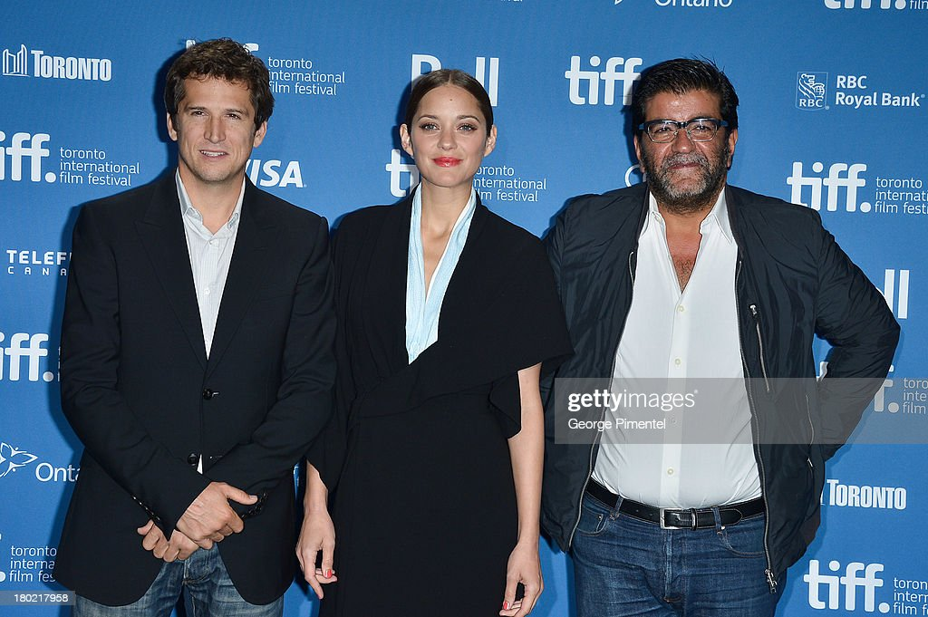 Director Guillaume Canet, Actress Marion Cotillard and Producer Alain Attal pose at the 'Blood Ties' Press Conference during the 2013 Toronto International Film Festival at TIFF Bell Lightbox on September 10, 2013 in Toronto, Canada.