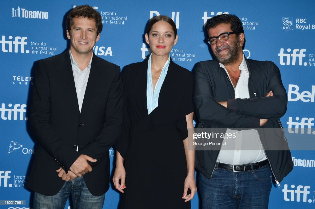 Director <a gi-track='captionPersonalityLinkClicked' href=/galleries/search?phrase=Guillaume+Canet&family=editorial&specificpeople=240267 ng-click='$event.stopPropagation()'>Guillaume Canet</a>, Actress <a gi-track='captionPersonalityLinkClicked' href=/galleries/search?phrase=Marion+Cotillard&family=editorial&specificpeople=215303 ng-click='$event.stopPropagation()'>Marion Cotillard</a> and Producer Alain Attal pose at the 'Blood Ties' Press Conference during the 2013 Toronto International Film Festival at TIFF Bell Lightbox on September 10, 2013 in Toronto, Canada.