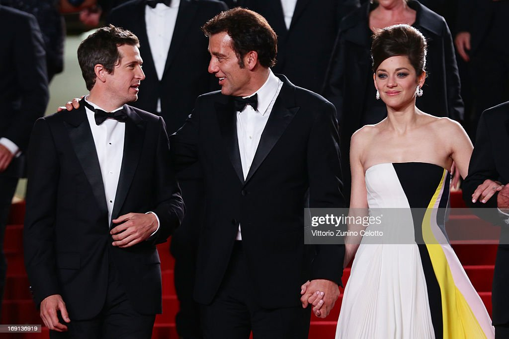 Director Guillaume Canet and actors Clive Owen and Marion Cotillard depart the 'Blood Ties' Premiere during the 66th Annual Cannes Film Festival at the Palais des Festivals on May 20, 2013 in Cannes, France.