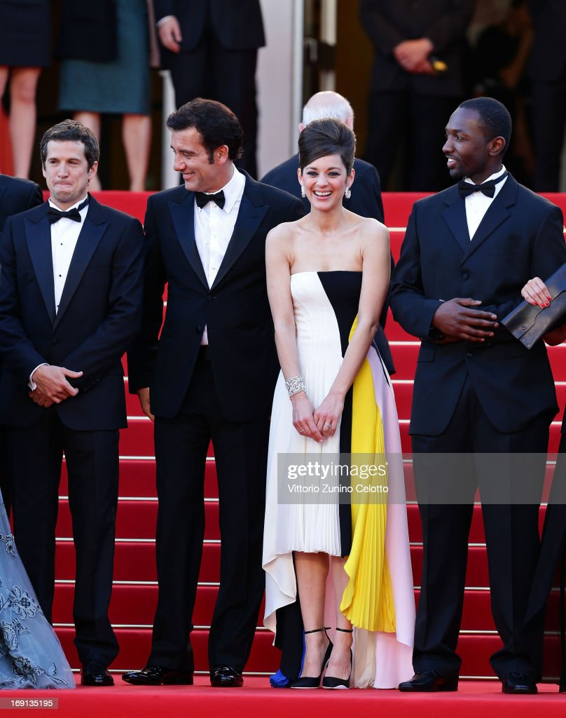 Director <a gi-track='captionPersonalityLinkClicked' href=/galleries/search?phrase=Guillaume+Canet&family=editorial&specificpeople=240267 ng-click='$event.stopPropagation()'>Guillaume Canet</a> and actors <a gi-track='captionPersonalityLinkClicked' href=/galleries/search?phrase=Clive+Owen&family=editorial&specificpeople=201515 ng-click='$event.stopPropagation()'>Clive Owen</a>, <a gi-track='captionPersonalityLinkClicked' href=/galleries/search?phrase=Marion+Cotillard&family=editorial&specificpeople=215303 ng-click='$event.stopPropagation()'>Marion Cotillard</a> and <a gi-track='captionPersonalityLinkClicked' href=/galleries/search?phrase=Jamie+Hector&family=editorial&specificpeople=666307 ng-click='$event.stopPropagation()'>Jamie Hector</a> attend the 'Blood Ties' Premiere during the 66th Annual Cannes Film Festival at the Palais des Festivals on May 20, 2013 in Cannes, France.