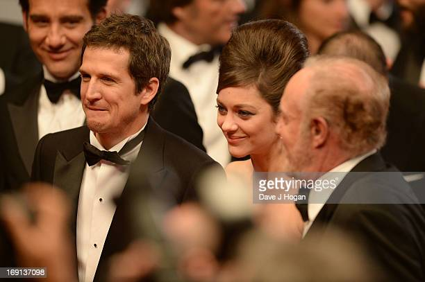 Director Guillaume Canet and actors Marion Cotillard and James Caan depart the 'Blood Ties' Premiere during the 66th Annual Cannes Film Festival at...