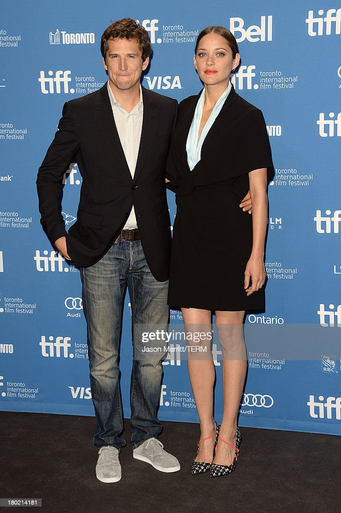 Director <a gi-track='captionPersonalityLinkClicked' href=/galleries/search?phrase=Guillaume+Canet&family=editorial&specificpeople=240267 ng-click='$event.stopPropagation()'>Guillaume Canet</a> and actress <a gi-track='captionPersonalityLinkClicked' href=/galleries/search?phrase=Marion+Cotillard&family=editorial&specificpeople=215303 ng-click='$event.stopPropagation()'>Marion Cotillard</a> attend 'Blood Ties' Press Conference during the 2013 Toronto International Film Festival at TIFF Bell Lightbox on September 10, 2013 in Toronto, Canada.