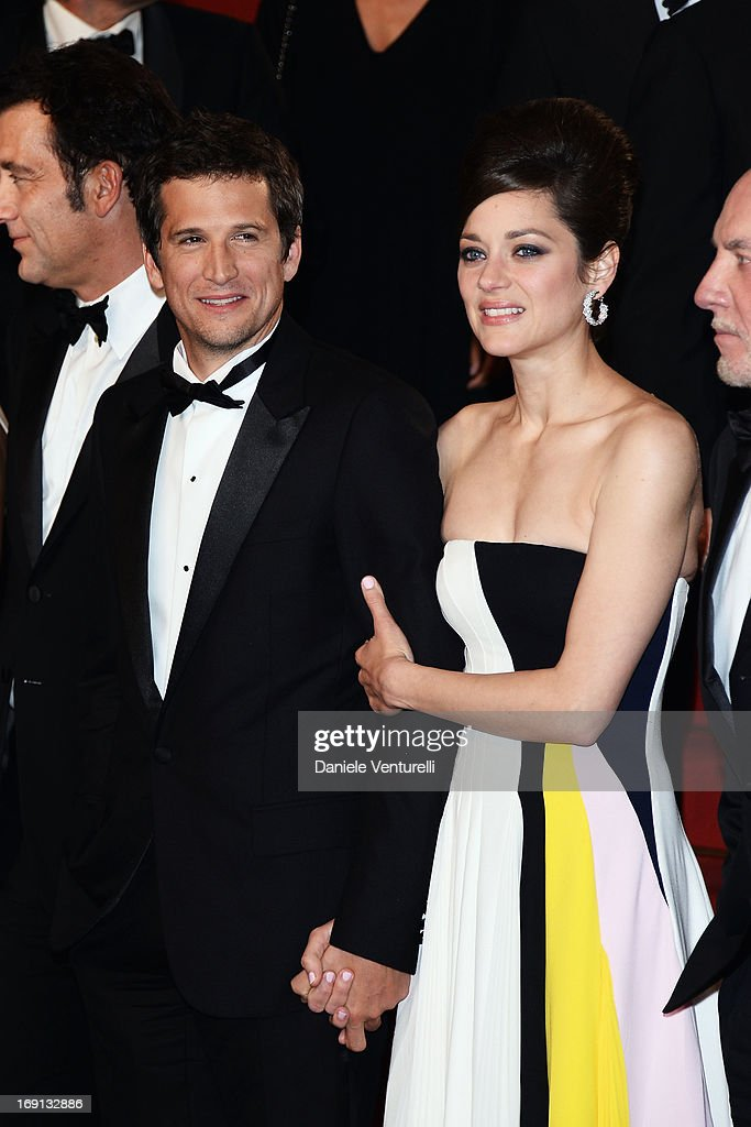 Director <a gi-track='captionPersonalityLinkClicked' href=/galleries/search?phrase=Guillaume+Canet&family=editorial&specificpeople=240267 ng-click='$event.stopPropagation()'>Guillaume Canet</a> and actress <a gi-track='captionPersonalityLinkClicked' href=/galleries/search?phrase=Marion+Cotillard&family=editorial&specificpeople=215303 ng-click='$event.stopPropagation()'>Marion Cotillard</a> leave the Premiere of 'Blood Ties' during the 66th Annual Cannes Film Festival at the Palais des Festivals on May 20, 2013 in Cannes, France.