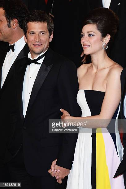 Director Guillaume Canet and actress Marion Cotillard leave the Premiere of 'Blood Ties' during the 66th Annual Cannes Film Festival at the Palais...
