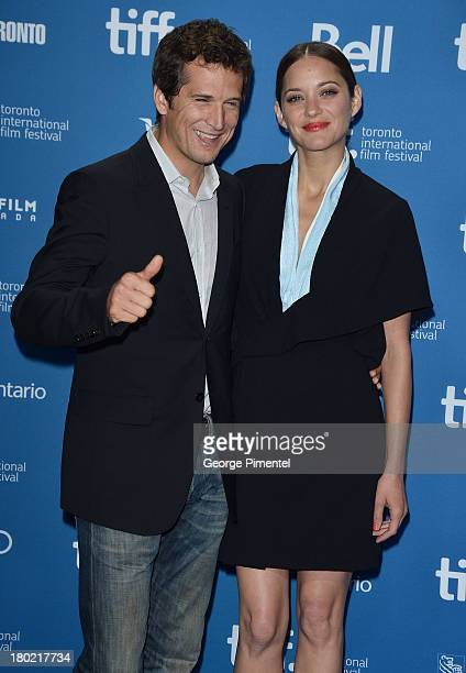 Director Guillaume Canet and Actress Marion Cotillard pose at the 'Blood Ties' Press Conference during the 2013 Toronto International Film Festival...