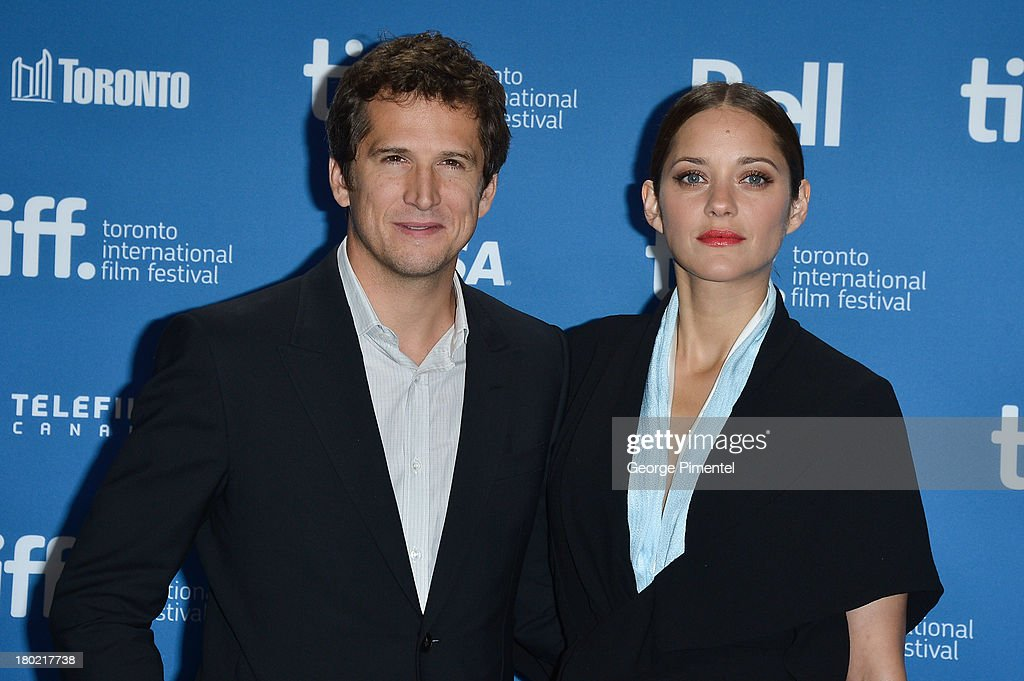 Director <a gi-track='captionPersonalityLinkClicked' href=/galleries/search?phrase=Guillaume+Canet&family=editorial&specificpeople=240267 ng-click='$event.stopPropagation()'>Guillaume Canet</a> and Actress <a gi-track='captionPersonalityLinkClicked' href=/galleries/search?phrase=Marion+Cotillard&family=editorial&specificpeople=215303 ng-click='$event.stopPropagation()'>Marion Cotillard</a> pose at the 'Blood Ties' Press Conference during the 2013 Toronto International Film Festival at TIFF Bell Lightbox on September 10, 2013 in Toronto, Canada.