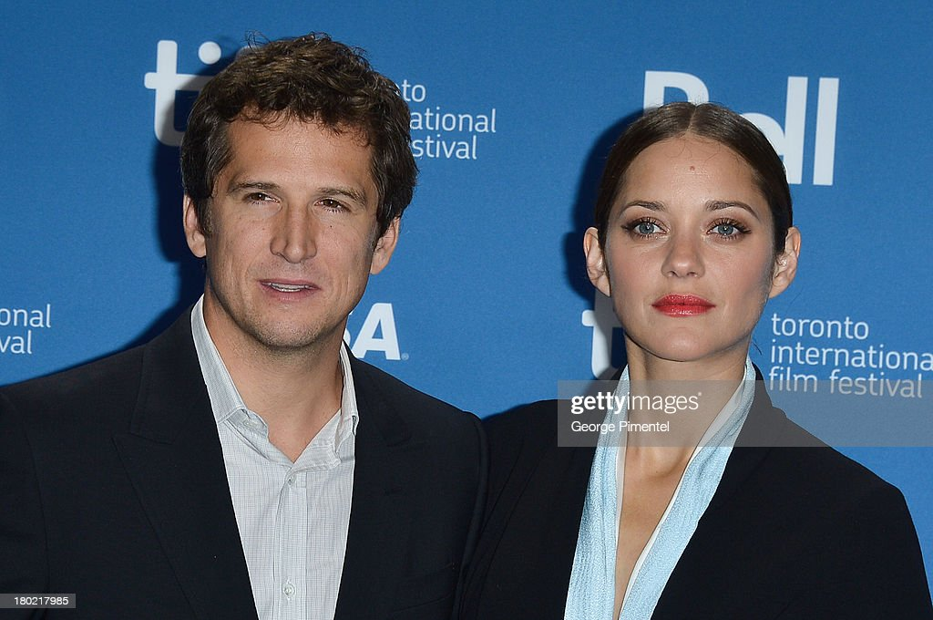 Director Guillaume Canet and Actress Marion Cotillard pose at the 'Blood Ties' Press Conference during the 2013 Toronto International Film Festival at TIFF Bell Lightbox on September 10, 2013 in Toronto, Canada.