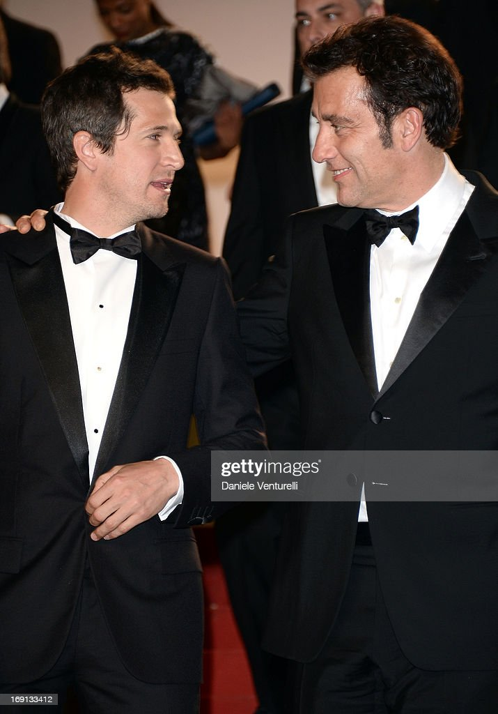Director Guillaume Canet and Clive Owen (R) leave the Premiere of 'Blood Ties' during the 66th Annual Cannes Film Festival at the Palais des Festivals on May 20, 2013 in Cannes, France.