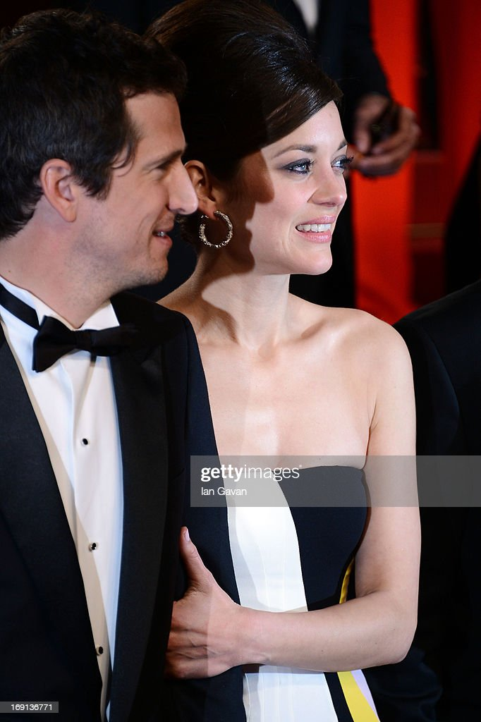 Director Guillaume Canet and Marion Cotillard depart the 'Blood Ties' Premiere during the 66th Annual Cannes Film Festival at the Palais des Festivals on May 20, 2013 in Cannes, France.
