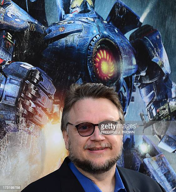 Director Guillermo Del Toro poses on arrival for the Los Angeles premiere of the film 'Pacific Rim' in Hollywood California on July 9 2013 The film...