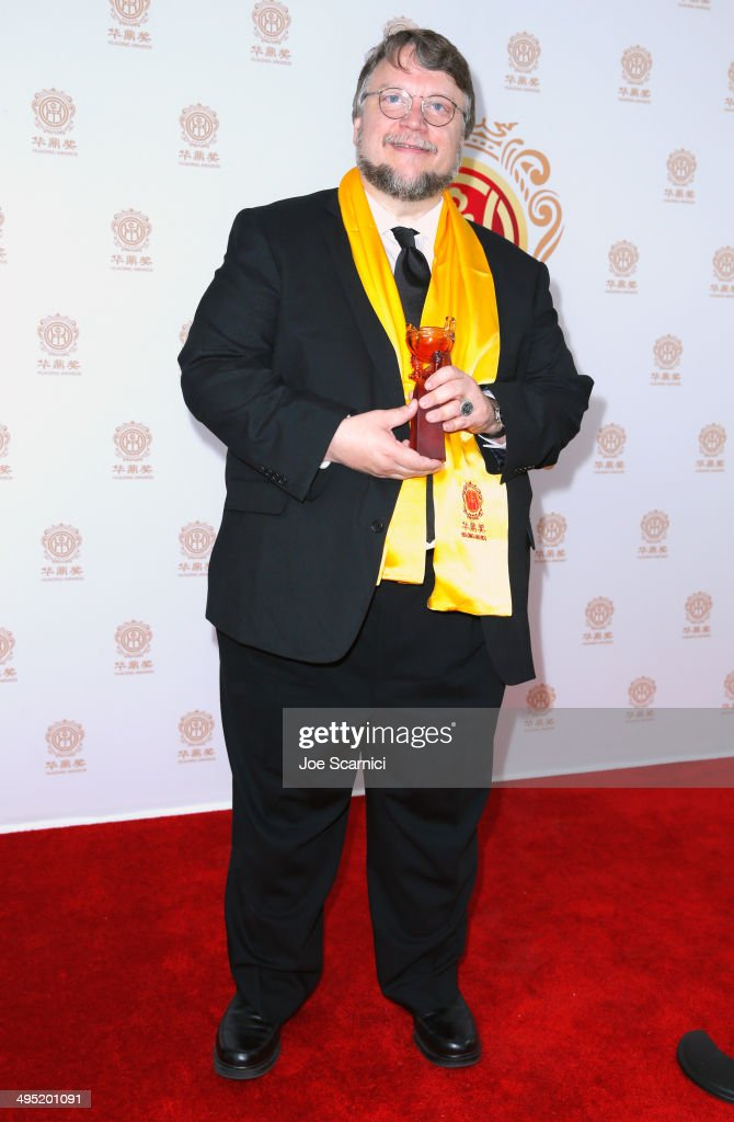 Director <a gi-track='captionPersonalityLinkClicked' href=/galleries/search?phrase=Guillermo+del+Toro&family=editorial&specificpeople=609181 ng-click='$event.stopPropagation()'>Guillermo del Toro</a> poses with the award for Best Global Director in the press room during the Huading Film Awards on June 1, 2014 at Ricardo Montalban Theatre in Los Angeles, California. Huading Film Awards is China's #1 Film awards, in the U.S. for the first time.