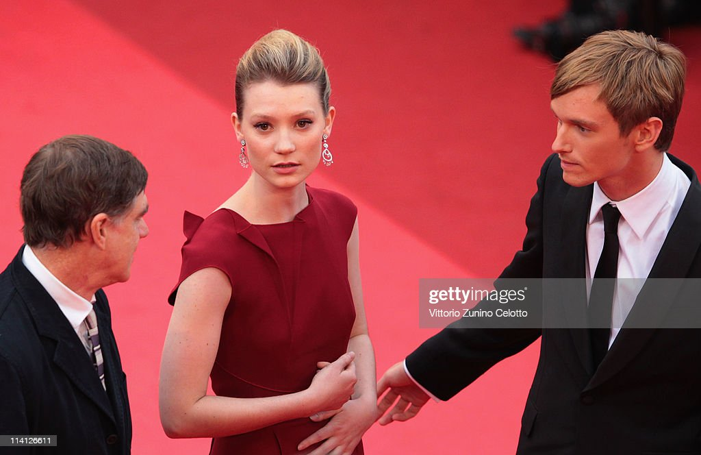 Director Gus van Sant (L) and actors Henry Hopper (R) and <a gi-track='captionPersonalityLinkClicked' href=/galleries/search?phrase=Mia+Wasikowska&family=editorial&specificpeople=3965263 ng-click='$event.stopPropagation()'>Mia Wasikowska</a> (C) arrive at the 'Restless' premiere during the 64th Annual Cannes Film Festival at the Palais des Festivals on May 12, 2011 in Cannes, France.