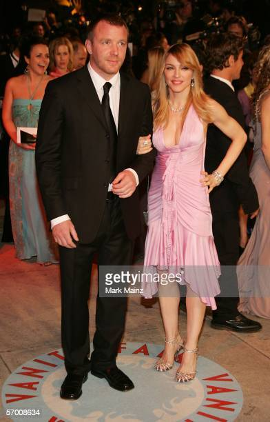 Director Guy Richie and singer Madonna leave the Vanity Fair Oscar Party at Mortons on March 5 2006 in West Hollywood California