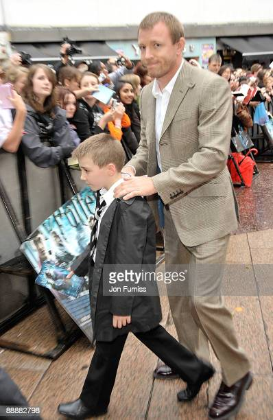 Director Guy Richie with his son Rocco attend the 'Harry Potter and the HalfBlood Prince' film premiere at the Odeon Leicester Square on July 7 2009...