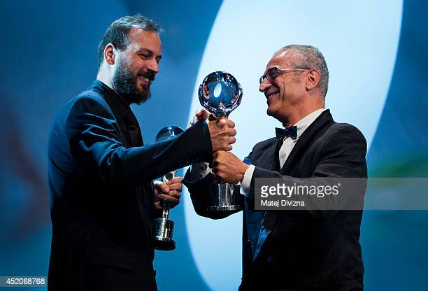 Director Gyorgy Palfi from Hungary receives the Crystal Globe Prize for best director for his movie Free Fall from President of the Jury director...