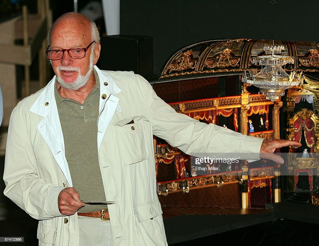 Director Hal Prince Speaks In Front Of A Model Of The New Theater Being  Built For