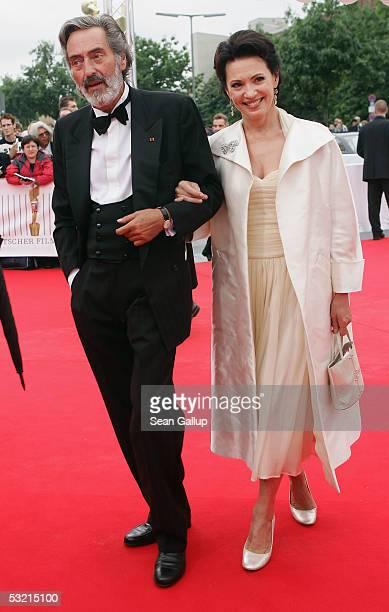 Director Helmut Dietl and actress Iris Berben arrive at the Deutscher Filmpreis the German Film Awards July 8 2005 at the Philharmonic in Berlin...