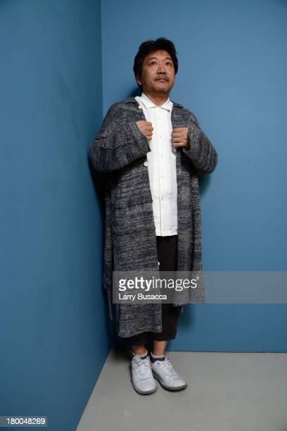 Director Hirokazu KoreEda of 'Like Father Like Son' poses at the Guess Portrait Studio during 2013 Toronto International Film Festival on September 8...