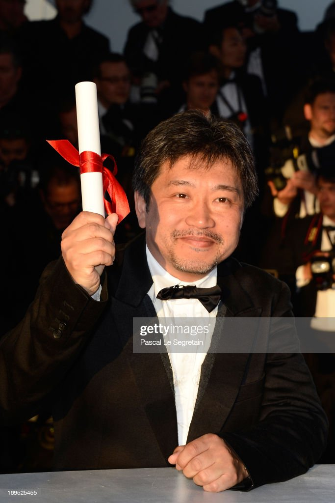 Director Hirokazu Koreeda poses with the 'Prix du jury' (Jury Prize) for 'Soshite Chichi Ni Naru' at the Palme D'Or Winners Photocall during the 66th Annual Cannes Film Festival at the Palais des Festivals on May 26, 2013 in Cannes, France.