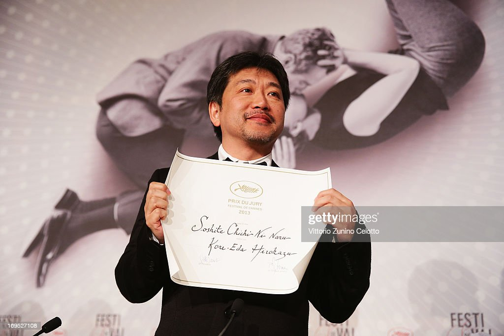 Director Hirokazu Koreeda, winner of the 'Prix du jury' (Jury Prize) for 'Soshite Chichi Ni Naru,' speaks the Palme D'Or Winners Press Conference during the 66th Annual Cannes Film Festival at the Palais des Festivals on May 26, 2013 in Cannes, France.