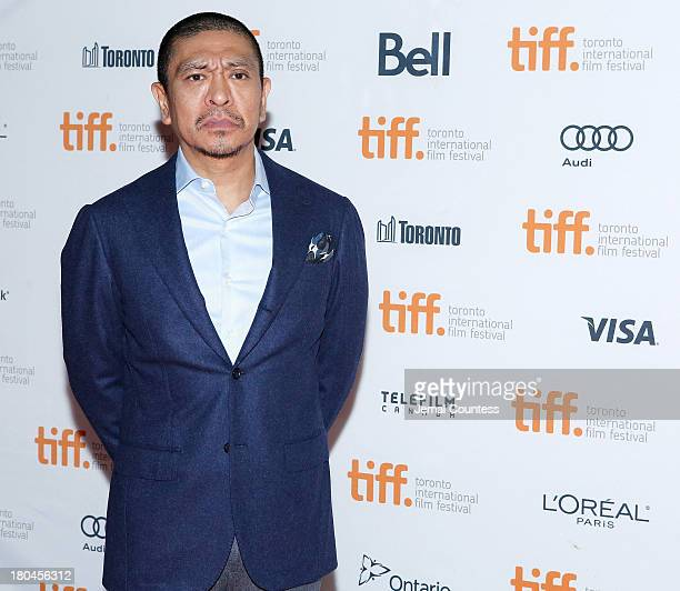 Director Hitoshi Matsumoto attends the premiere of 'R100' at Ryerson Theatre on September 12 2013 in Toronto Canada