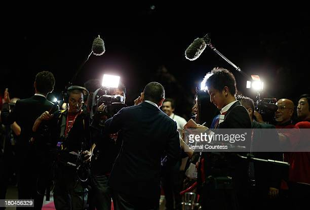 Director Hitoshi Matsumoto speaks to the media at the premiere of 'R100' at Ryerson Theatre on September 12 2013 in Toronto Canada