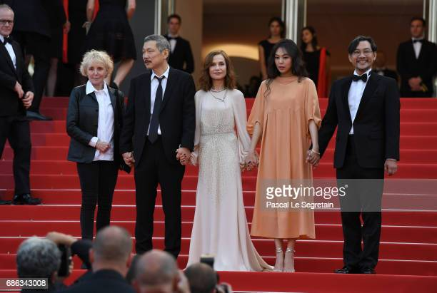 Director Hong SangSoo Isabelle Huppert Kim Minheet and Jeong Jinyoung of 'Claire's Camera ' walk the red carpet ahead of the 'The Meyerowitz Stories'...
