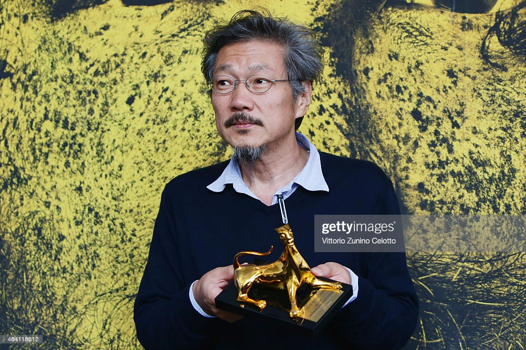 Director Hong Sangsoo poses with the Pardo d'Oro on August 15, 2015 in Locarno, Switzerland.