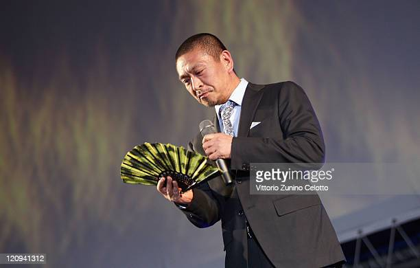 Director Hotoshi Matsumoto attends the 'Pardo alla Carriera' red carpet during the 64th Festival del Film di Locarno on August 12 2011 in Locarno...