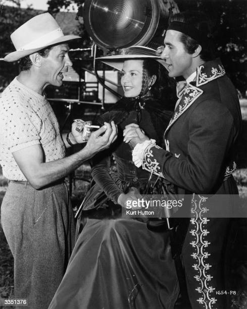 Director Hugo Fregonese discusses a love scene with Cyd Charisse and Ricardo Montalban during the filming of the Universal picture 'The Mark Of The...