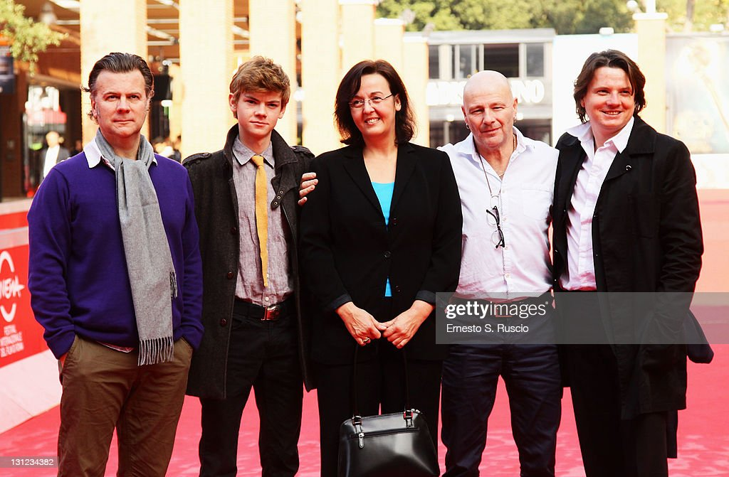 Director Ian Fitzgibbon, actor Thomas Brodie-Sangster and producers Astrid Kahmke, Michael Garland and Philipp Kreuzer attend the 'Death of a Super Hero' photocall during the 6th International Rome Film Festival on November 3, 2011 in Rome, Italy.
