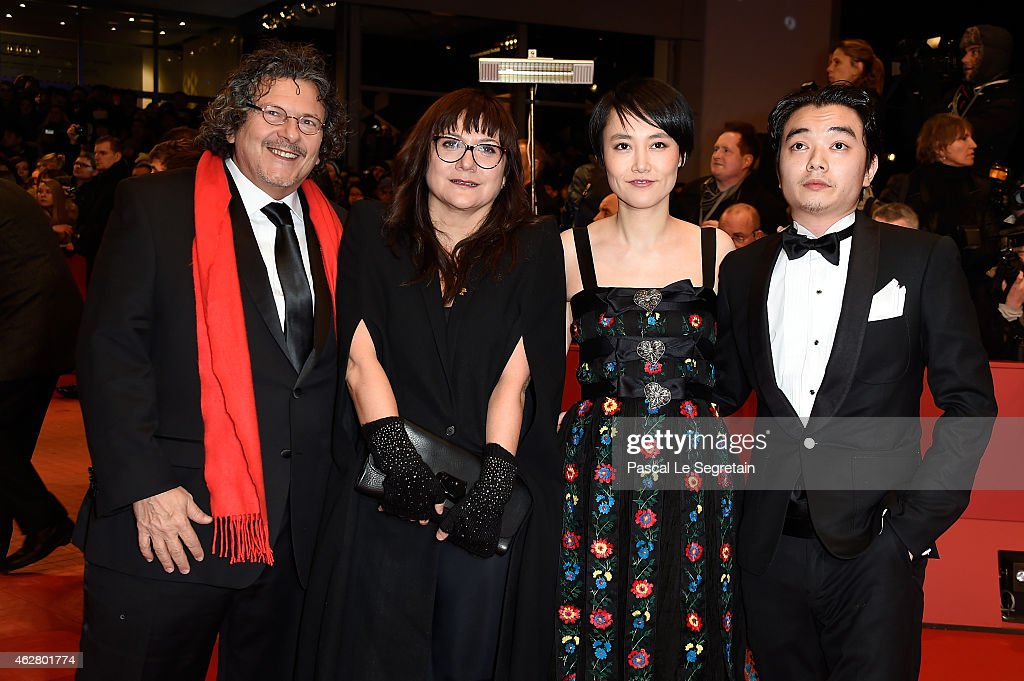 Director Isabel Coixet actress Rinko Kikuchi and her husband actor Shota Sometani attend the 'Nobody Wants the Night' Opening Night premiere during...