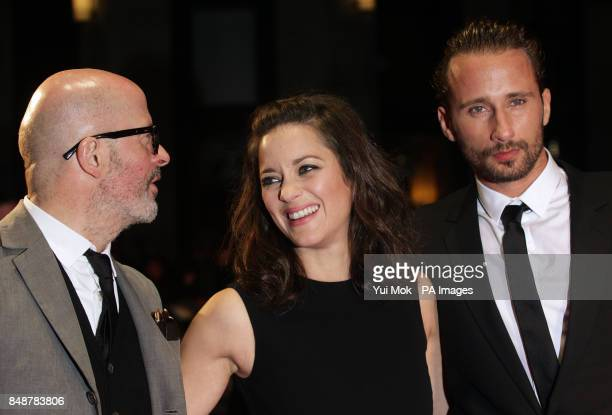 Director Jacques Audiard Marion Cotillard and Matthias Schoenaerts arriving for the BFI London Film Festival screening of Rust And Bone at the Odeon...