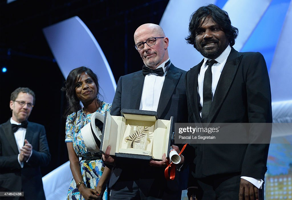 Director Jacques Audiard poses onstage with actress Kalieaswari Srinivasan and actor Jesuthasan Antonythasan after receiving the Palme D'Or for his...