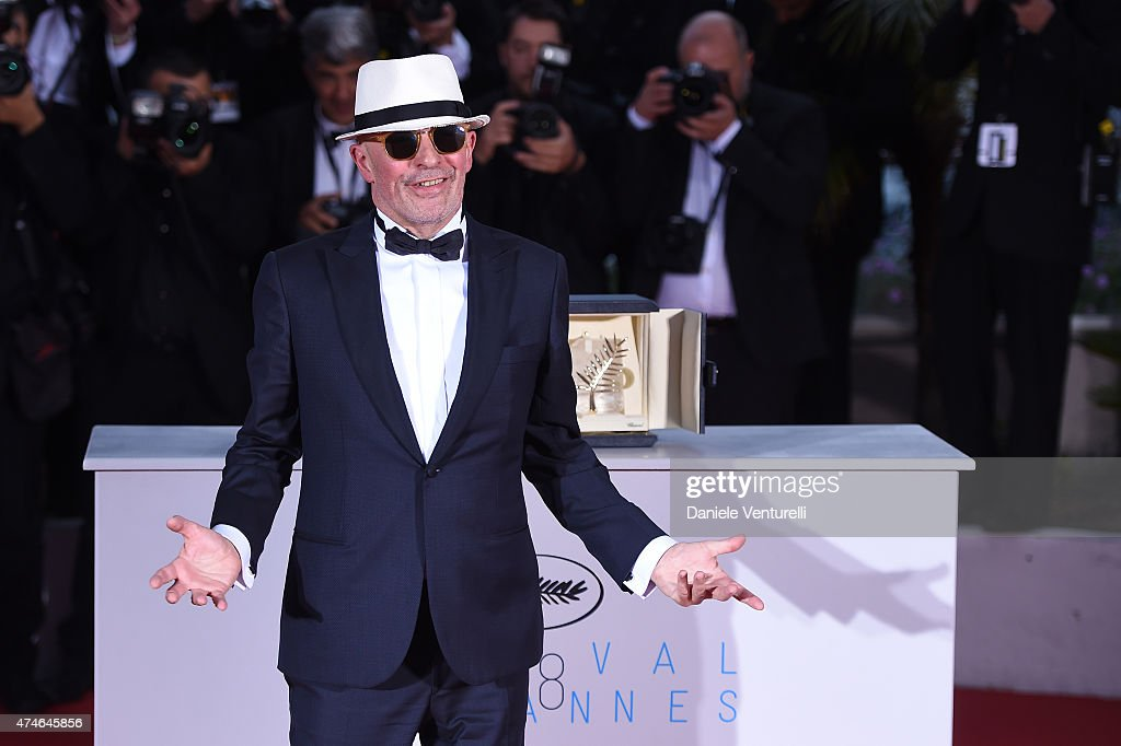 Director Jacques Audiard poses with the Palme d'Or won for 'Dheepan' during a photocall for the winners of the Palm D'Or during the 68th annual...
