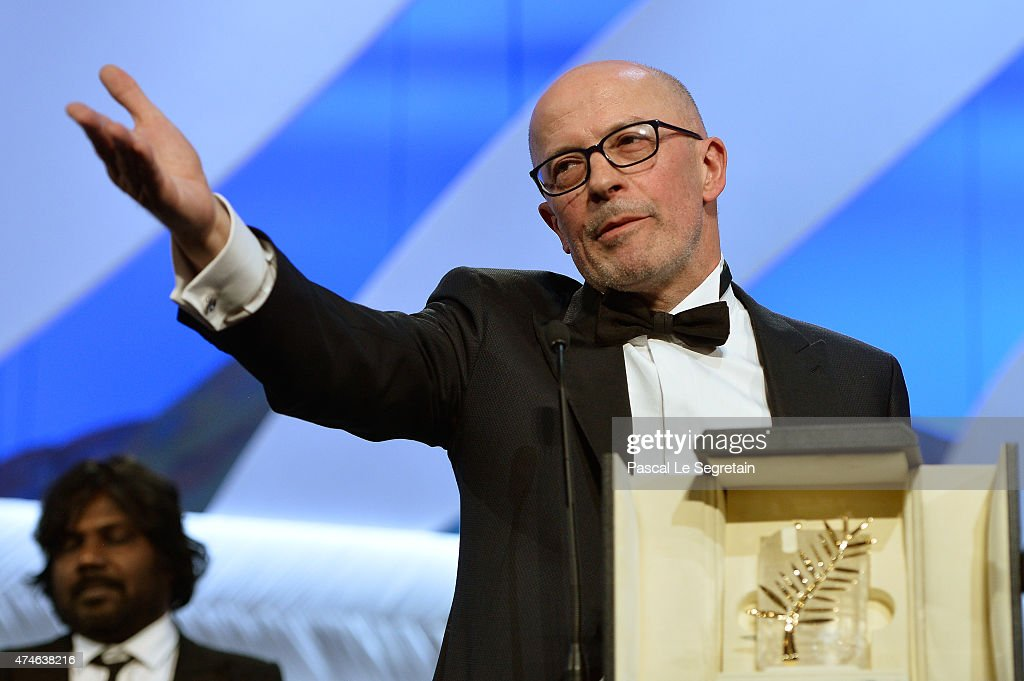 Director Jacques Audiart poses with The Palm d'Or for his film 'Dheepan' at the closing ceremony during the 68th annual Cannes Film Festival on May...