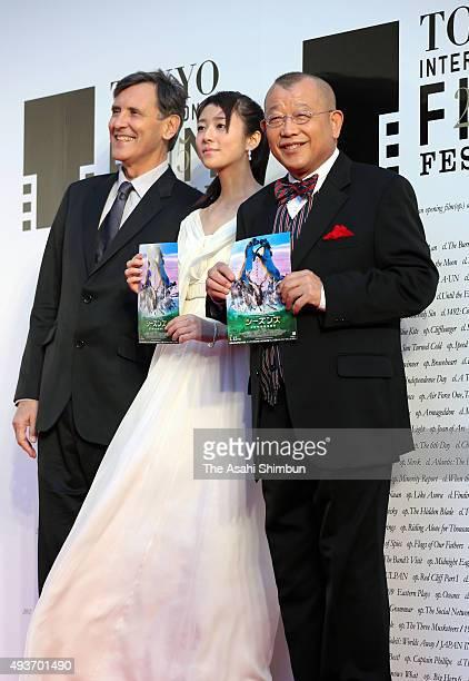 Director Jacques Cluzaud actress Fumino Kimura and rakugo storyteller Shofukutei Tsurube pose for photographs during the opening ceremony of the...