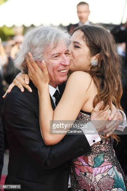Director Jacques Doillon and Izia Higelin depart after the 'Rodin' screening during the 70th annual Cannes Film Festival at Palais des Festivals on...