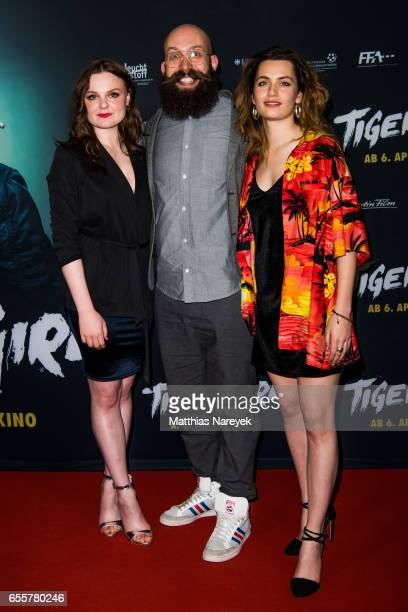 Director Jakob Lass Ella Rumpf and Maria Dragus attend the premiere of the film 'Tiger Girl' at Zoo Palast on March 20 2017 in Berlin Germany