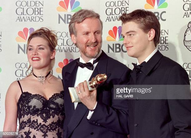 Director James Cameron and actress Kate Winslet and actor Leonardo DiCaprio pose for photographers after Cameron won the award for Best Director for...