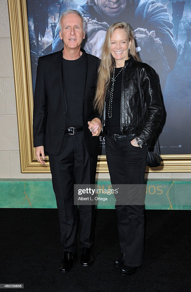 Director James Cameron and actress/wife Suzy Amis arrive for Premiere Of New Line Cinema MGM Pictures And Warner Bros Pictures' 'The Hobbit The...