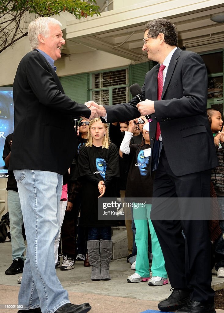 Director James Cameron and Chairman CEO Fox Film Entertainment Tom Rothman plant first tree in North America symbolizing the one million tree...
