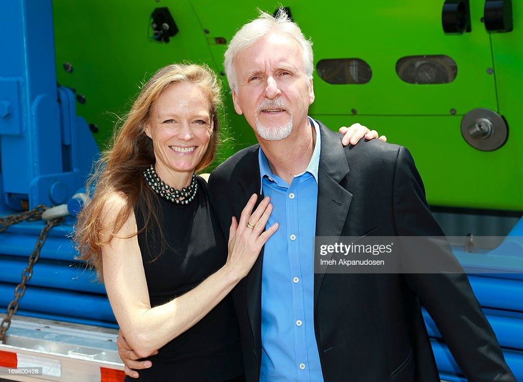 Director <a gi-track='captionPersonalityLinkClicked' href=/galleries/search?phrase=James+Cameron&family=editorial&specificpeople=206399 ng-click='$event.stopPropagation()'>James Cameron</a> (R) and his wife, actress <a gi-track='captionPersonalityLinkClicked' href=/galleries/search?phrase=Suzy+Amis&family=editorial&specificpeople=790397 ng-click='$event.stopPropagation()'>Suzy Amis</a>, attend the Deepsea Challenger photocall at California Science Center on June 1, 2013 in Los Angeles, California.