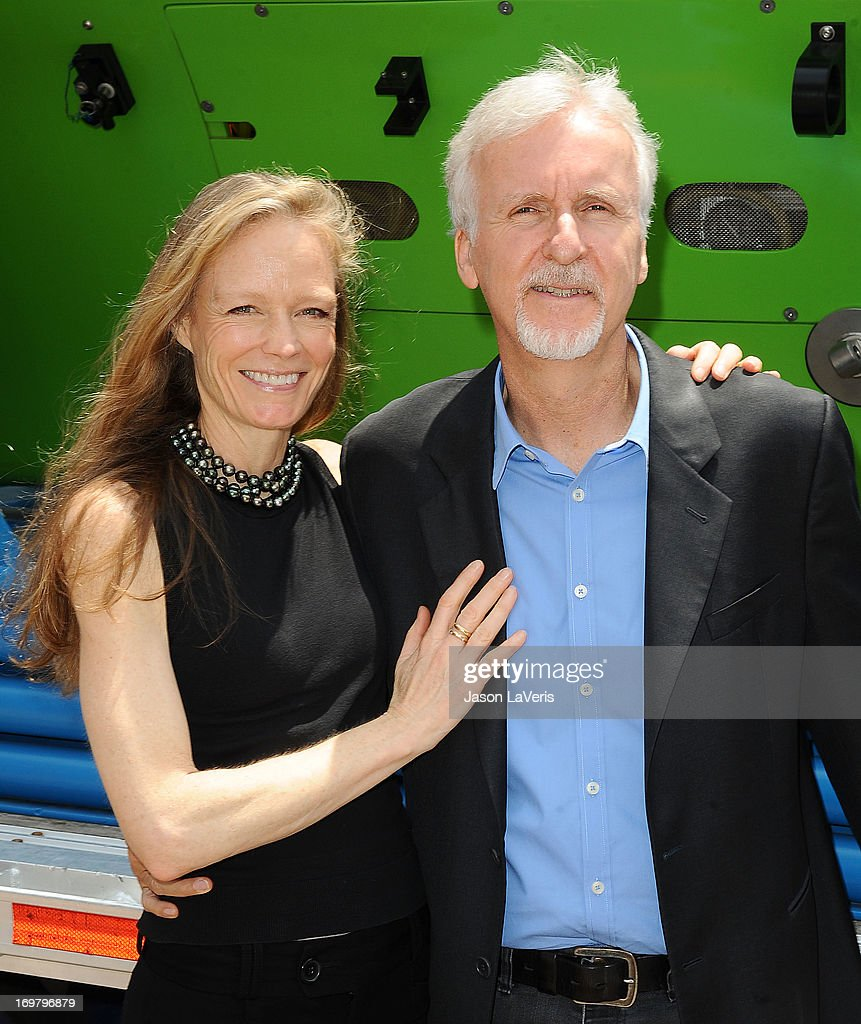 Director <a gi-track='captionPersonalityLinkClicked' href=/galleries/search?phrase=James+Cameron&family=editorial&specificpeople=206399 ng-click='$event.stopPropagation()'>James Cameron</a> (R) and wife <a gi-track='captionPersonalityLinkClicked' href=/galleries/search?phrase=Suzy+Amis&family=editorial&specificpeople=790397 ng-click='$event.stopPropagation()'>Suzy Amis</a> attend the Deepsea Challenger photocall at California Science Center on June 1, 2013 in Los Angeles, California.