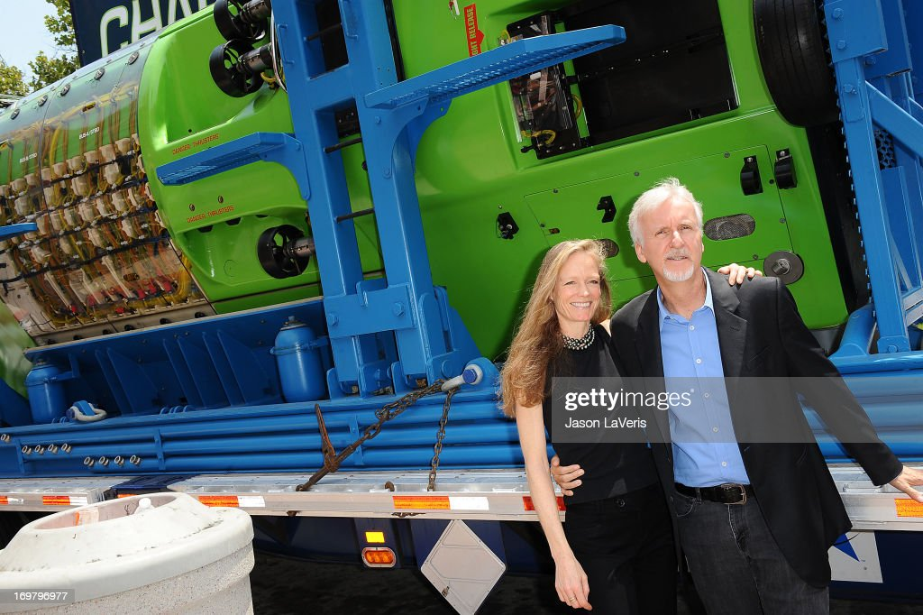 Director James Cameron (R) and wife Suzy Amis attend the Deepsea Challenger photocall at California Science Center on June 1, 2013 in Los Angeles, California.