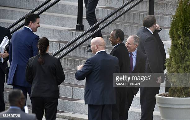 FBI Director James Comey is seen with US president elect Donald Trump's nominees for housing and urban development secretary Ben Carson and EPA...