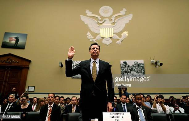 Director James Comey is sworn in during a hearing before House Oversight and Government Reform Committee July 7 2016 on Capitol Hill in Washington DC...